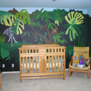 Photo of a medium sized world-inspired nursery for girls in Los Angeles with multi-coloured walls and carpet.