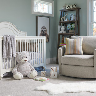 Design ideas for a medium sized traditional gender neutral nursery in Charlotte with blue walls, carpet and white floors.