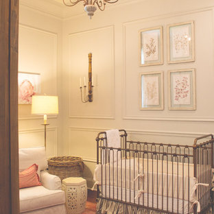 Example of a mid-sized transitional girl carpeted nursery design in New Orleans with white walls