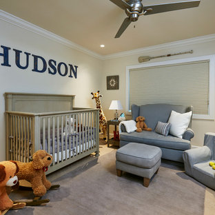 Mid-sized beach style nursery in Miami with beige walls and carpet for boys.