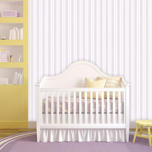 Cottage chic nursery photo in Wilmington with purple walls