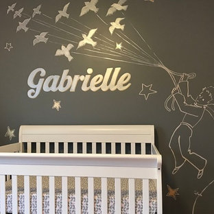 Large classic nursery for girls in Toronto with pink walls.