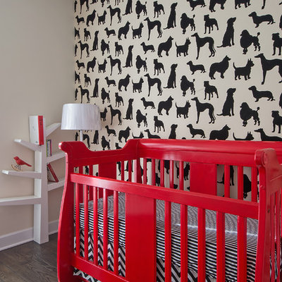 Example of a trendy gender-neutral medium tone wood floor nursery design in Chicago with multicolored walls