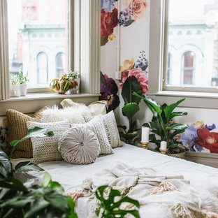 Inspiration for a large tropical girl nursery remodel in Vancouver with white walls