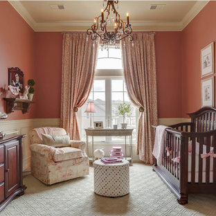 Inspiration for a mid-sized traditional nursery for girls in Kansas City with pink walls.
