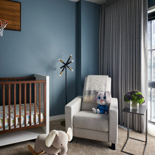 Inspiration for a mid-sized contemporary nursery for boys in Chicago with blue walls, carpet and brown floor.