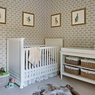 Design ideas for a medium sized classic gender neutral nursery in London with carpet, multi-coloured walls and beige floors.