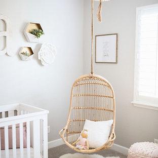 На фото: комната для малыша среднего размера в стиле шебби-шик с серыми стенами, ковровым покрытием и бежевым полом для девочки