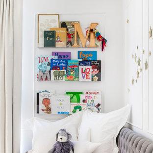 На фото: комната для малыша среднего размера в стиле модернизм с белыми стенами, мраморным полом, белым полом и панелями на части стены для мальчика
