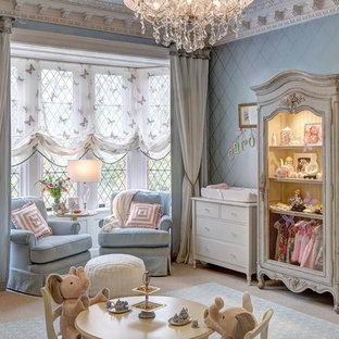 Design ideas for a large traditional nursery for girls in New York with blue walls, carpet and beige floors.