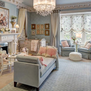 Design ideas for a large classic nursery for girls in New York with blue walls, carpet and beige floors.