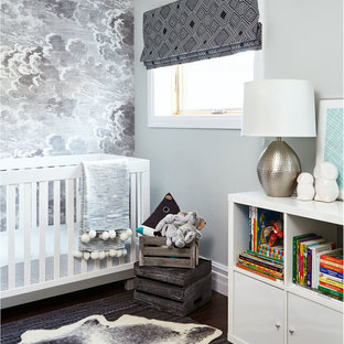Photo of a contemporary nursery for boys in Toronto with grey walls, dark hardwood flooring and brown floors.