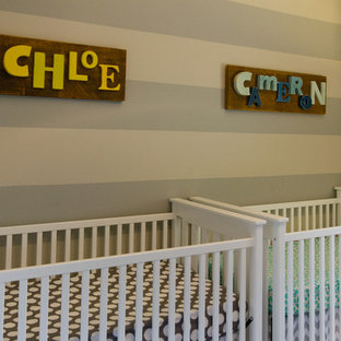 Example of a small transitional gender-neutral nursery design in Chicago with beige walls