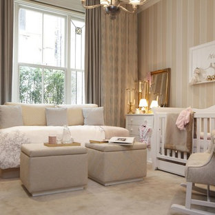 Photo of a traditional nursery in London with carpet and beige floor.