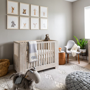 Design ideas for a medium sized beach style gender neutral nursery in Miami with beige floors, light hardwood flooring and beige walls.