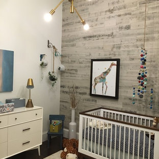 Inspiration for a mid-sized eclectic boy dark wood floor nursery remodel in Miami with white walls