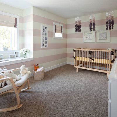 Nursery - mid-sized transitional girl carpeted and gray floor nursery idea in Vancouver with pink walls