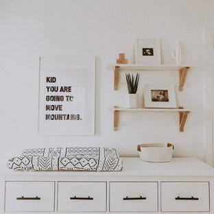 Nursery - mid-sized modern boy carpeted and beige floor nursery idea in Other with white walls