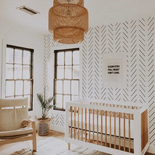 This is an example of a medium sized scandi nursery for boys in Dallas with white walls, carpet and brown floors.
