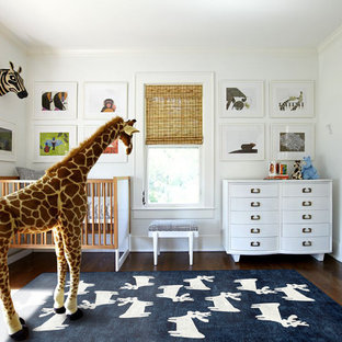 Classic nursery for boys in Dallas with white walls, dark hardwood flooring and brown floors.