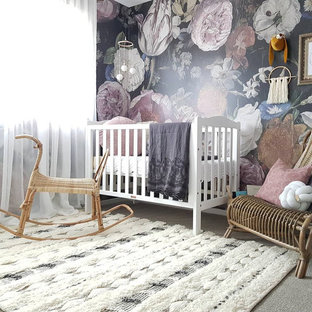 Country nursery in Sydney with multi-coloured walls, carpet and grey floor for girls.