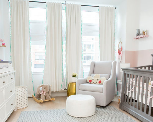 inspiration for a transitional girl beige floor nursery remodel in new york with pink walls - Nursery Design Ideas