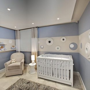Inspiration for a mid-sized modern boy nursery remodel in Other with blue walls