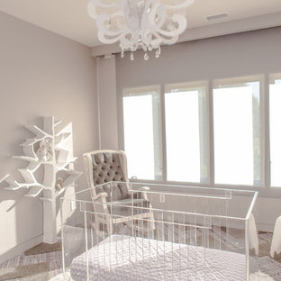 Inspiration for a medium sized modern nursery for girls in Charlotte with grey walls and carpet.