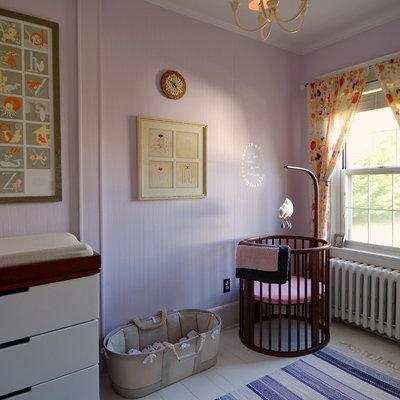 Nursery - scandinavian girl painted wood floor nursery idea in New York with pink walls