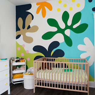 Bohemian gender neutral nursery in Cincinnati with white walls, dark hardwood flooring and brown floors.