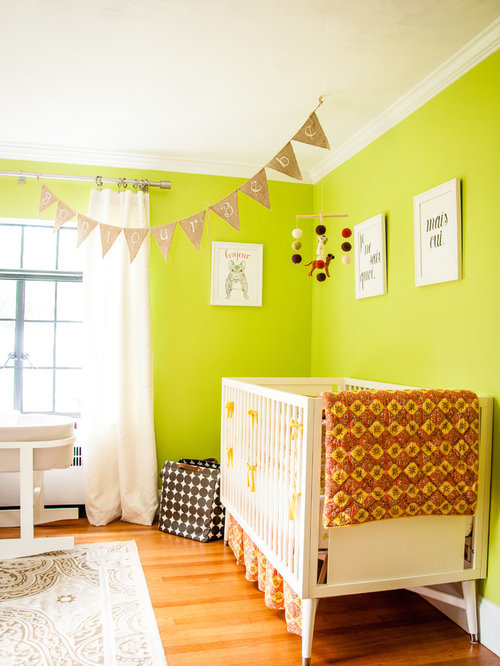 Eclectic Nursery Dublin Eclectic gender-neutral nursery photo in Boston with green walls and medium tone hardwood floors