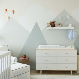 Inspiration for a medium sized contemporary nursery for boys in New York with beige walls and medium hardwood flooring.