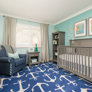 Photo of a medium sized traditional nursery for boys in San Francisco with green walls and dark hardwood flooring.