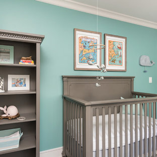 Photo of a mid-sized traditional nursery for boys in San Francisco with green walls and dark hardwood floors.