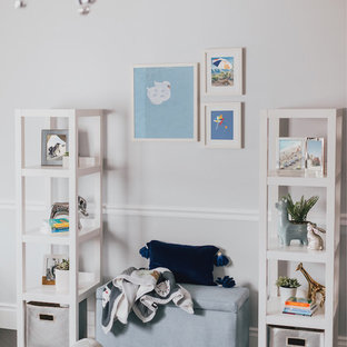 Design ideas for a medium sized modern nursery for boys in Los Angeles with white walls, dark hardwood flooring and white floors.