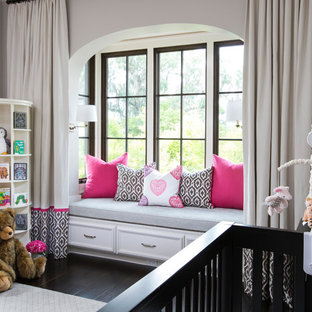 Photo of a mediterranean nursery for girls in Jacksonville with dark hardwood flooring.