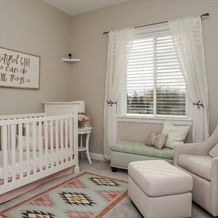 Inspiration for a mid-sized contemporary girl carpeted and beige floor nursery remodel in Salt Lake City with beige walls