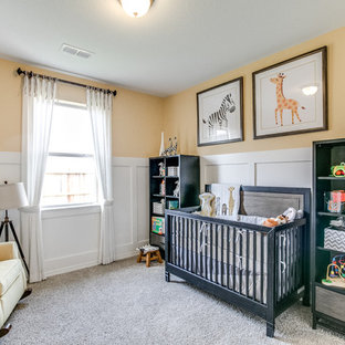 Elegant gender-neutral carpeted and gray floor nursery photo in Houston with yellow walls