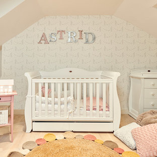 Contemporary nursery in London with beige floors.