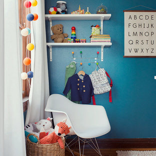 Photo of a modern nursery for boys in Salt Lake City with blue walls.