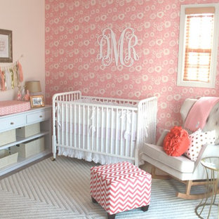 Inspiration for a mid-sized traditional nursery for girls in Orange County with pink walls and carpet.