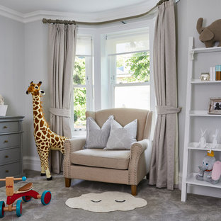 This is an example of a classic gender neutral nursery in London with grey walls, carpet and grey floors.