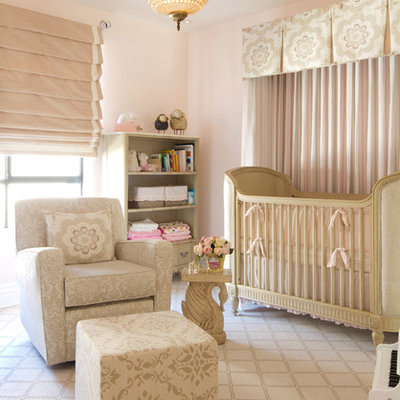 Large transitional girl carpeted nursery photo in Los Angeles with pink walls