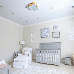This is an example of a large eclectic gender neutral nursery in Charlotte with beige walls and carpet.