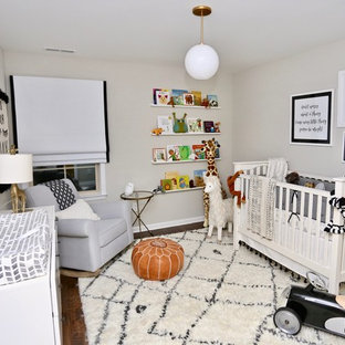 Design ideas for a modern gender neutral nursery in Other with grey walls, dark hardwood flooring and brown floors.