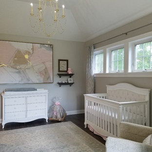 Inspiration for a large classic nursery for girls in Other with grey walls, medium hardwood flooring and grey floors.