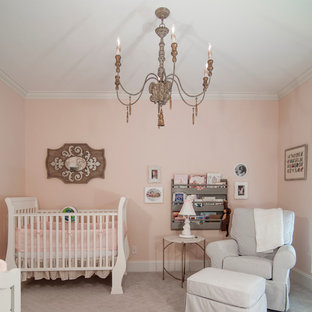 Medium sized classic nursery for girls in Charlotte with pink walls and carpet.