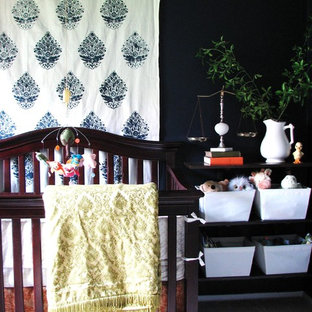 Eclectic gender neutral nursery in DC Metro with black walls and carpet.