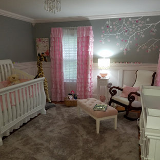 Inspiration for a medium sized classic nursery for girls in Manchester with grey walls, medium hardwood flooring and orange floors.