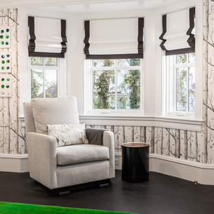 Design ideas for a medium sized contemporary nursery for boys in New York with white walls, dark hardwood flooring and black floors.